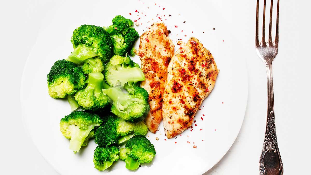 Chicken breast and broccoli on a plate are part of an ideal diet for lower blood pressure