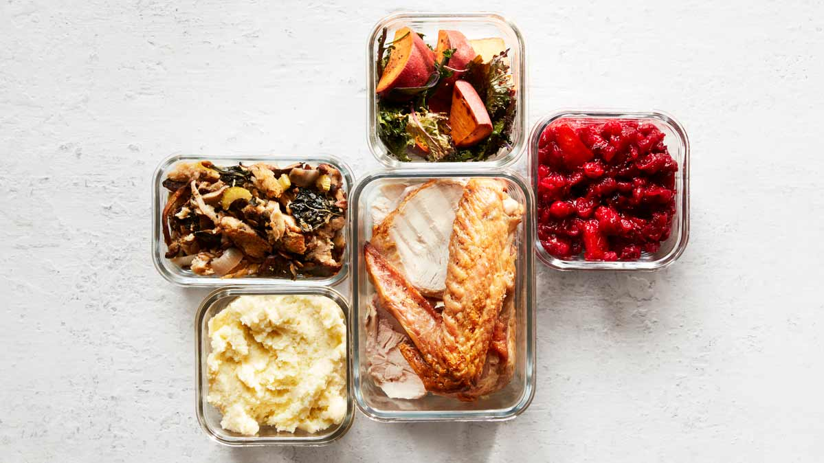 Thanksgiving dinner leftovers in clear glass containers