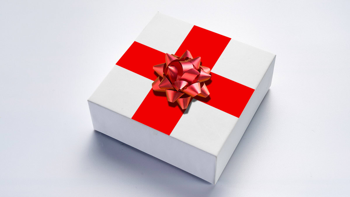 An image of a gift box with a red cross and a bow.