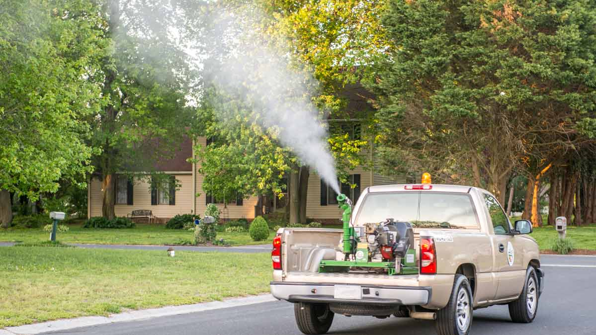 A truck sprays anti-mosquito pyrethroid pesticides.