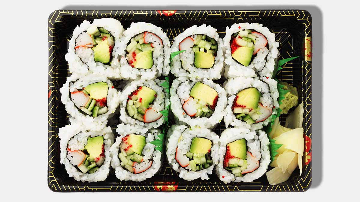 A takeout container with California rolls