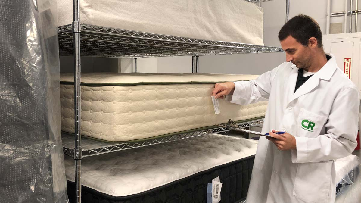 CR's project leader inspecting every mattress as part of our tests to find the best mattresses.