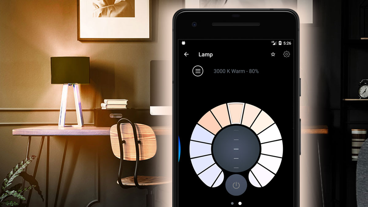 A smartphone with a smart lighting app on the screen.