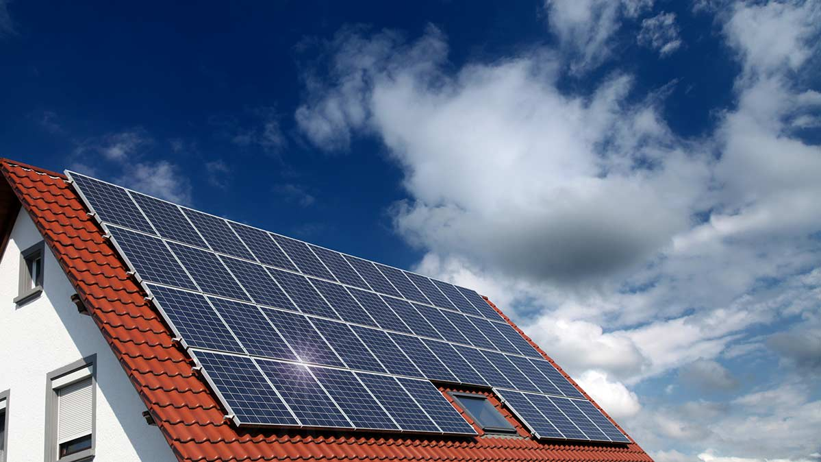 Solar panels on a red-tile roof