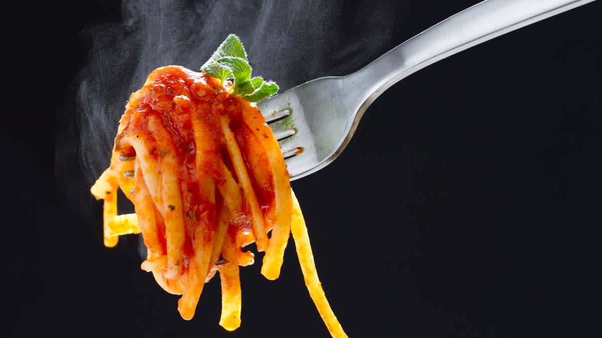 A forkful of spaghetti with healthy pasta sauce