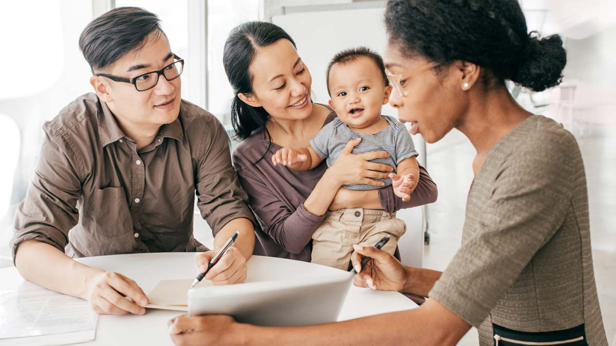 A family with their tax preparer