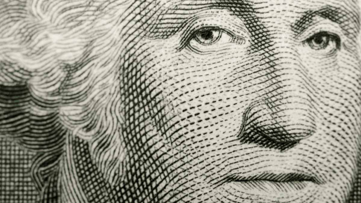 A close-up of George Washington from one-dollar bill