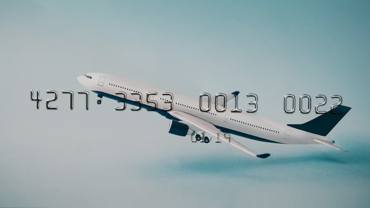 Image of a plane in flight on a credit card.