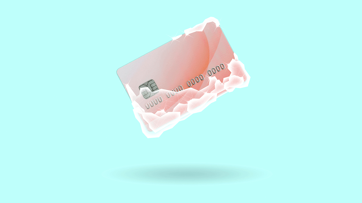 A credit card with ice to represent a credit freeze.