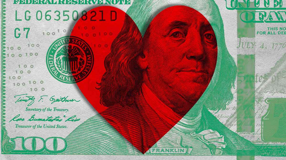 A $100 bill with a heart superimposed on it