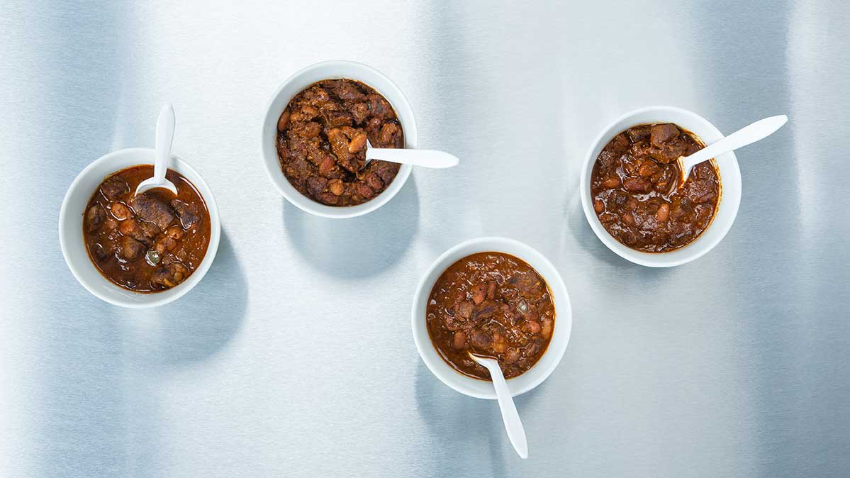 Four bowls of chili in a cook-off tasting.