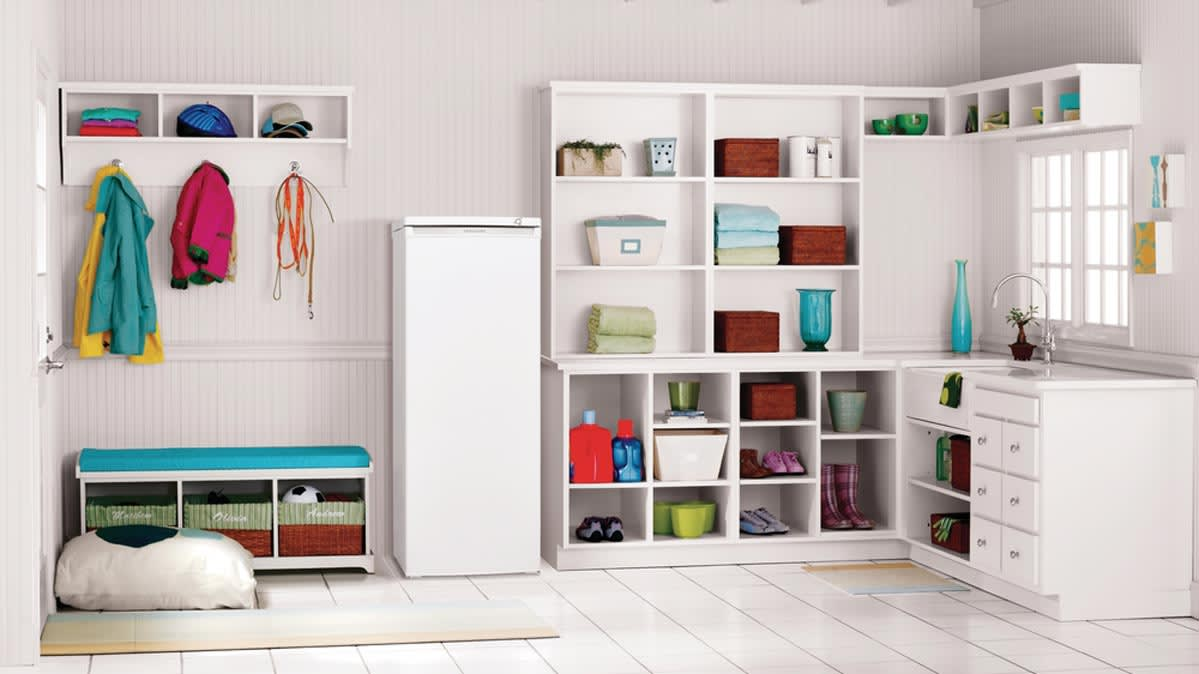 A laundry room with one of the best small freezers.