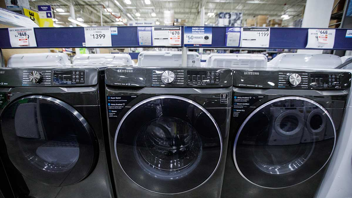 A row of washing machines for sale in a store