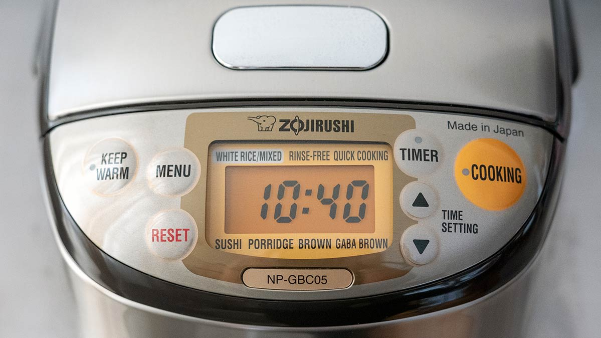 A close-up of the Zojirushi rice cooker's control panel.