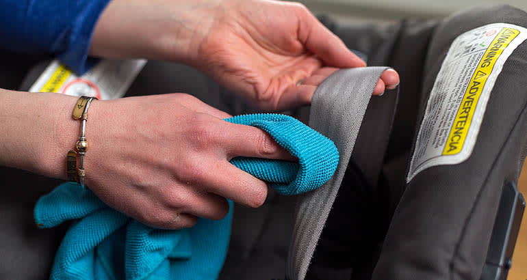Cleaning the straps on a car seat