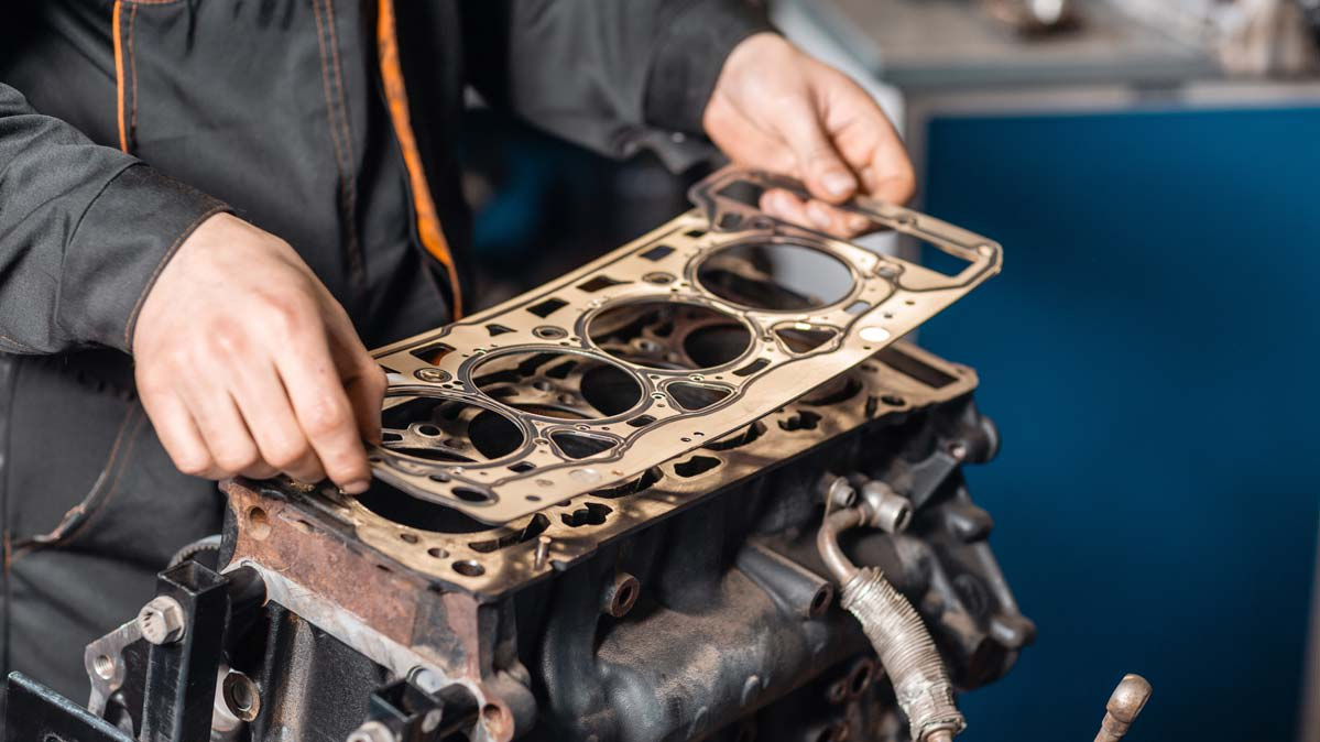A mechanic replacing a head gasket