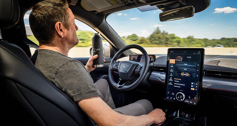 A drivier in a 2021 Mustang Mach-E with Co-Pilot360 ADAS system.