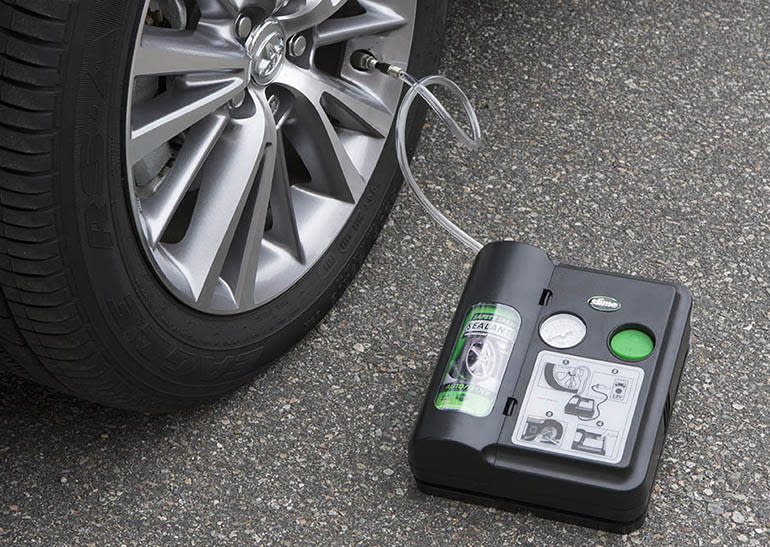 Tire sealant kit being used