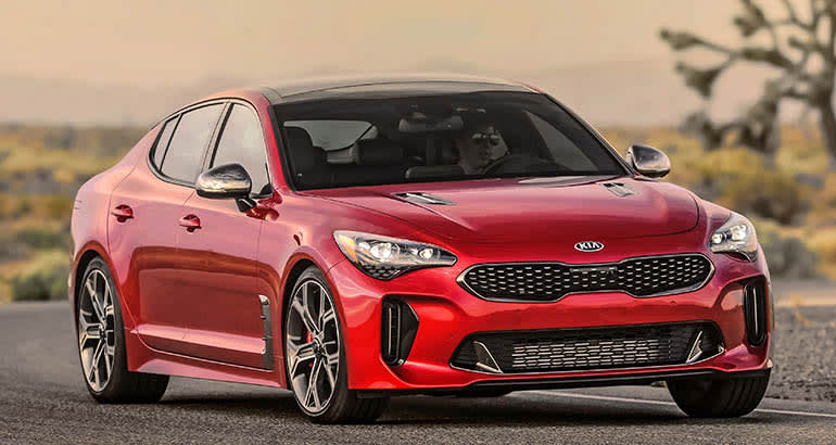A recalled 2019 Kia Stinger sedan, in red. Front view.