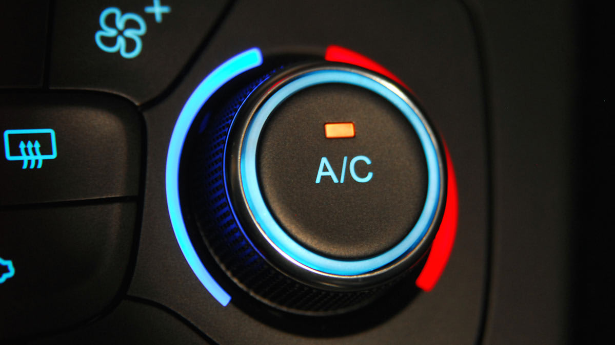 The air conditioning on/off button for a car