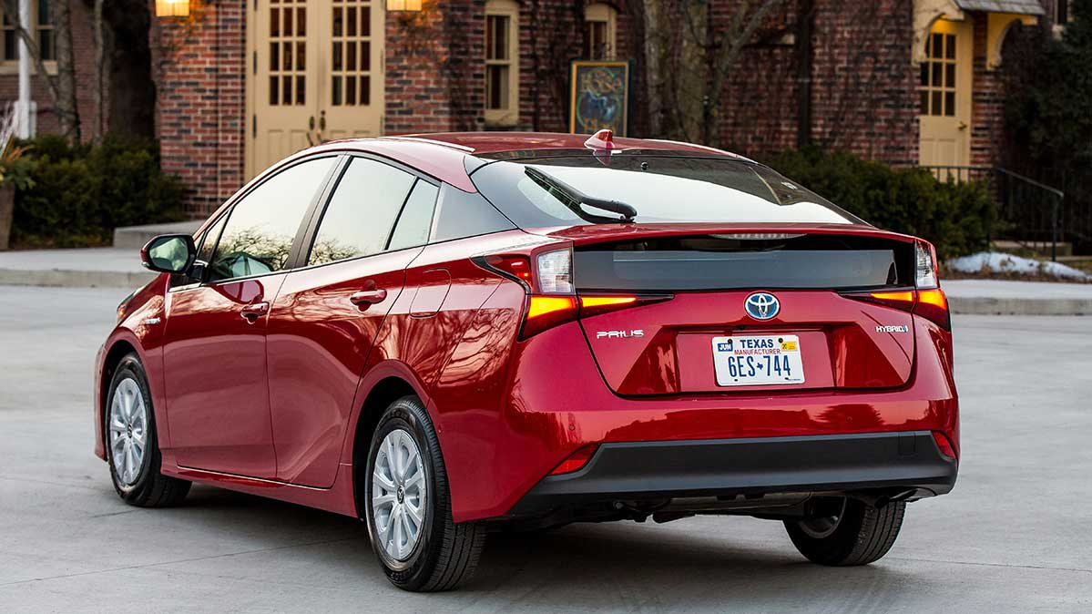 A red Toyota Prius shown from the rear