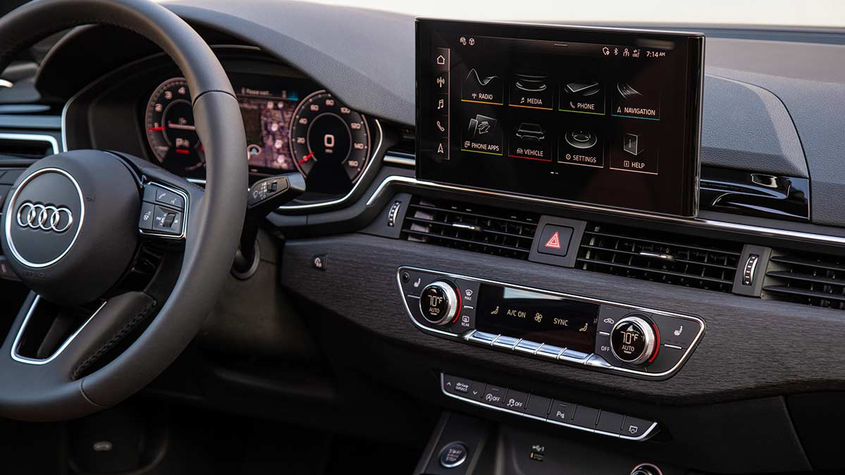 The interior of an Audi showing the dashboard and infotainment system
