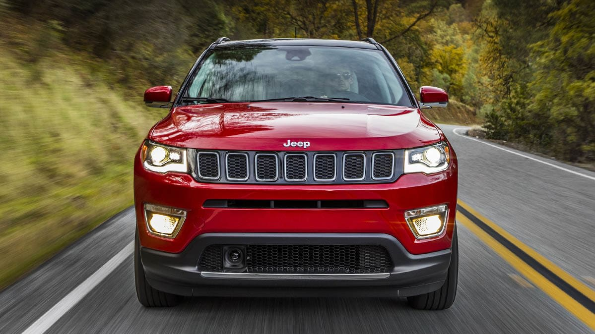 A red Jeep Compass SUV