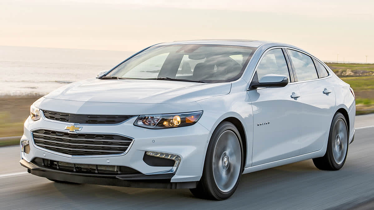 A 2018 Chevrolet Malibu sedan in white, front view