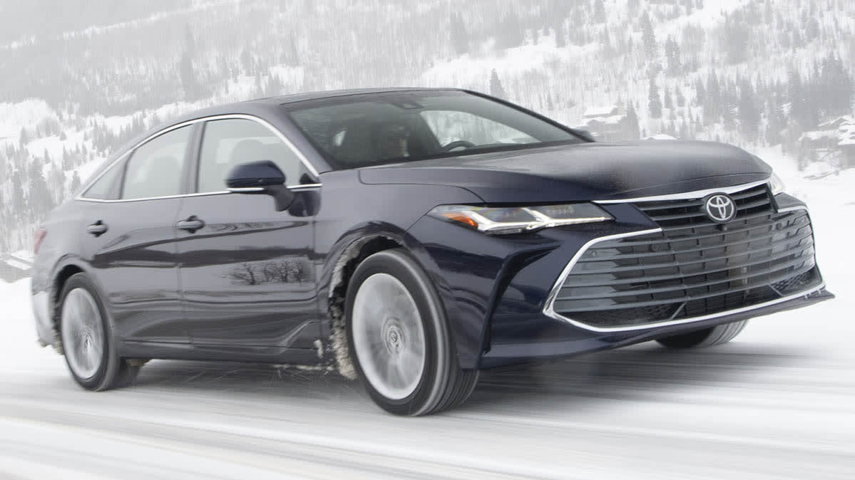 A Toyota Avalon driving on snow