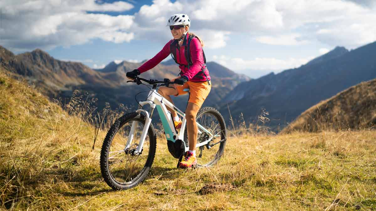A person riding an electric bike on a mountain trail