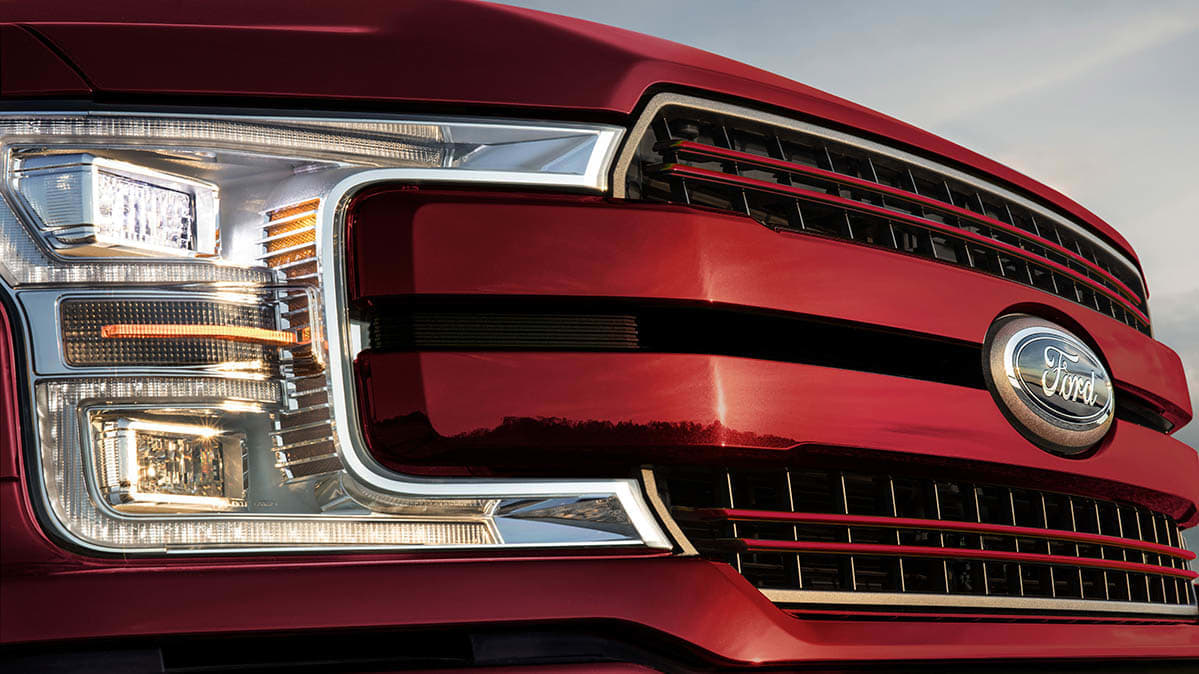 a close up photo of Ford F-150 headlights — recalled because their daytime running lights can stay on even when the low-beams are on