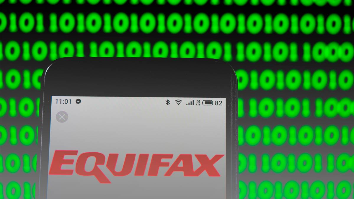 A mobile phone with the name Equifax on the screen
