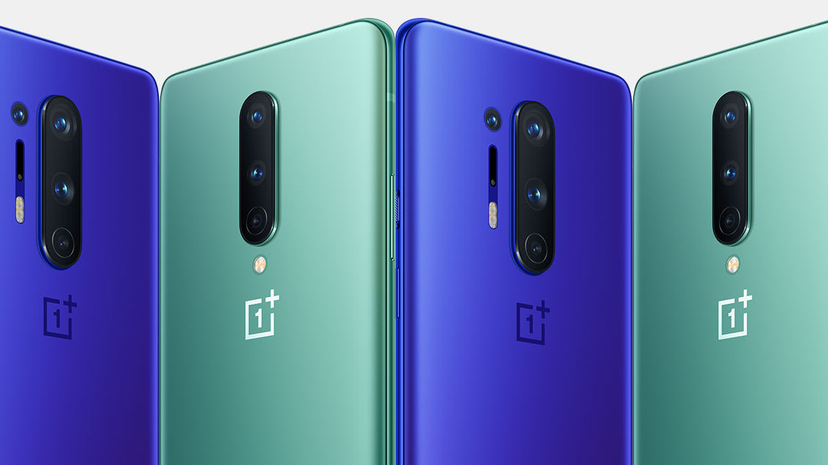 A row of OnePlus 8 and OnePlus 8 Pro phones in green and blue versions.