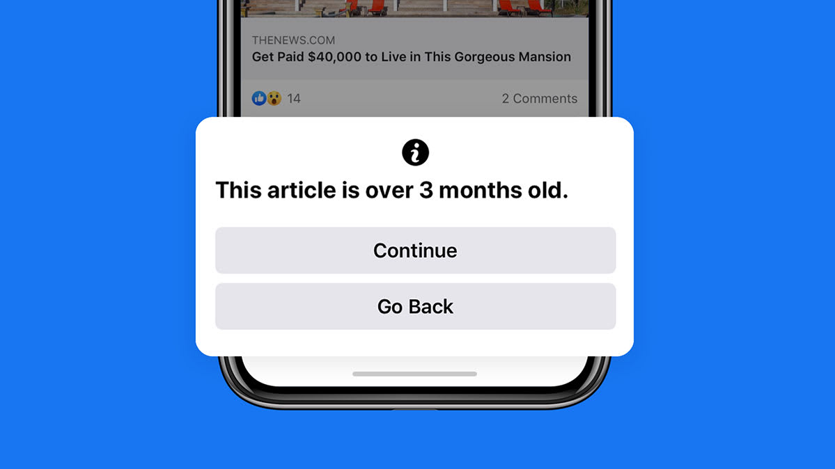 A screenshot showing Facebook's pop-up notification when users share outdated content, part of efforts to fight misinformation.