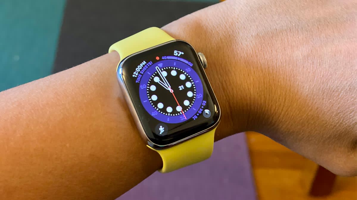 An Apple Watch Series 6 smartwatch with a yellow band on a user's wrist