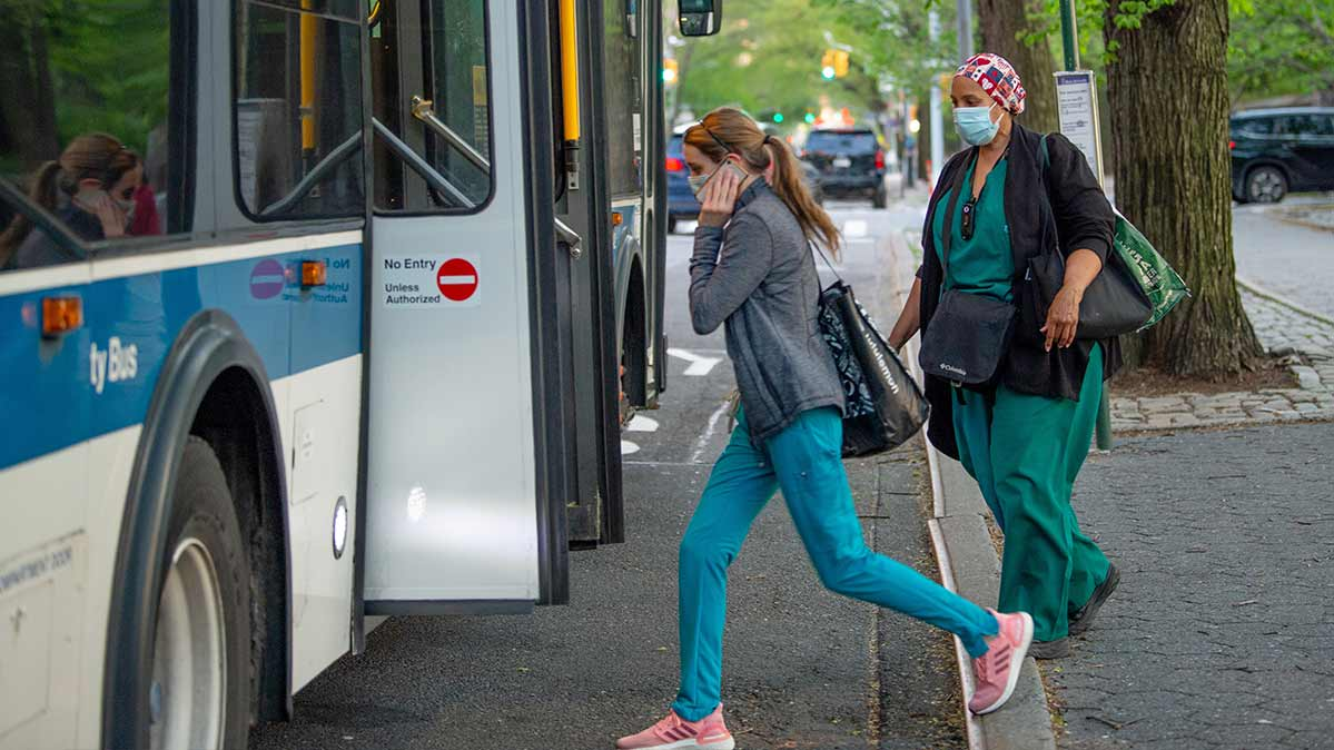 Medical workers in New York City commute via bus amid the coronavirus pandemic.