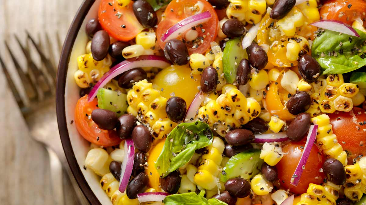 A salad with black beans.