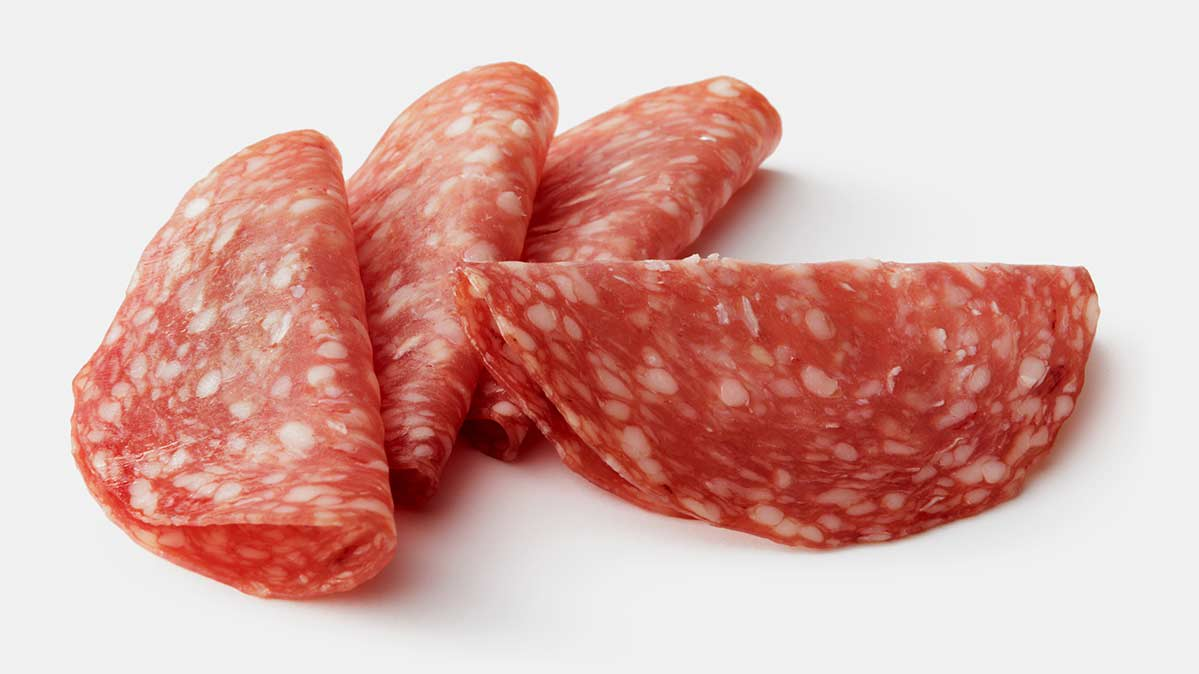 Four folded-over slices of salami
