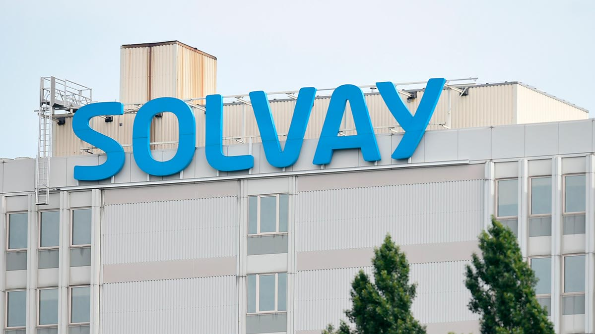 A sign showing the name of Solvay, a chemical company.
