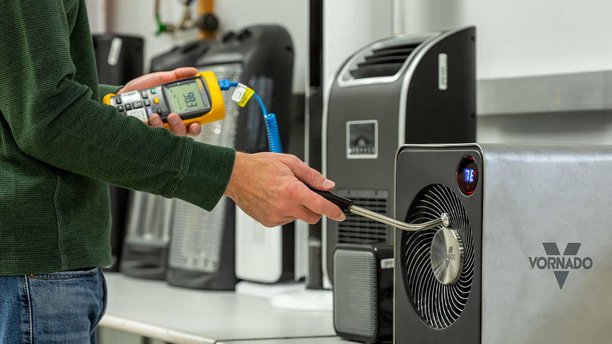 A Consumer Reports engineer testing a space heater