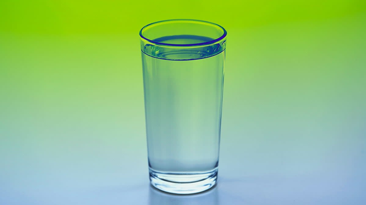 A glass of water on a table