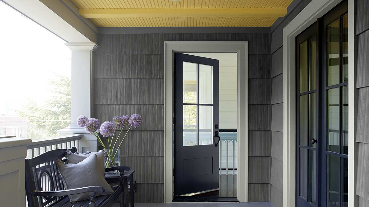 This exterior paint color is gray, and the doors are dark gray with a hint of blue.
