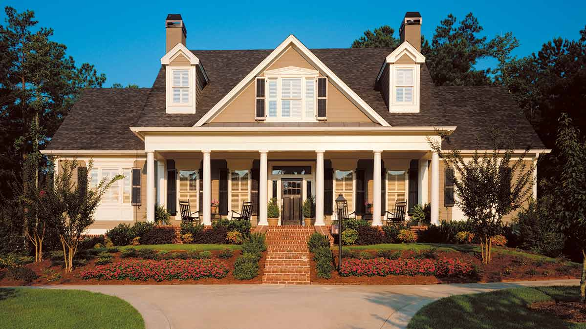 The exterior paint color is a caramel beige. The shutters are black.