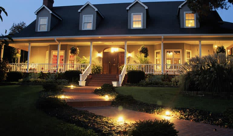 Exterior of a home with outdoor lighting