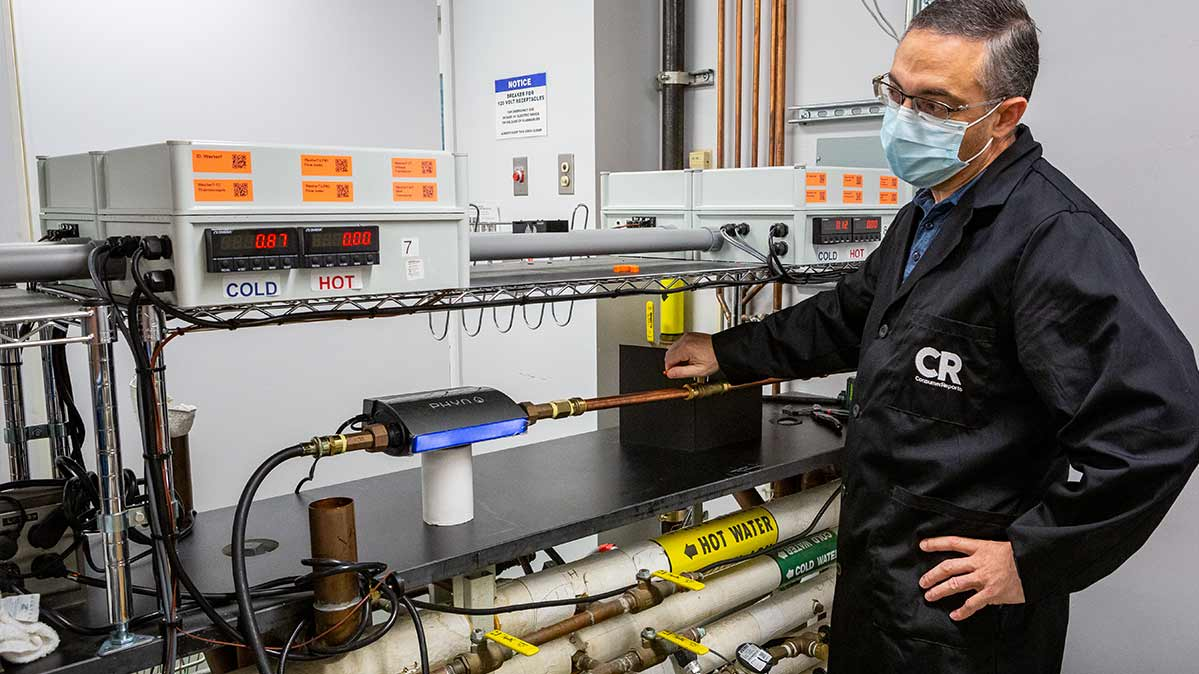 A CR engineer running tests on a professionally installed water leak detector system