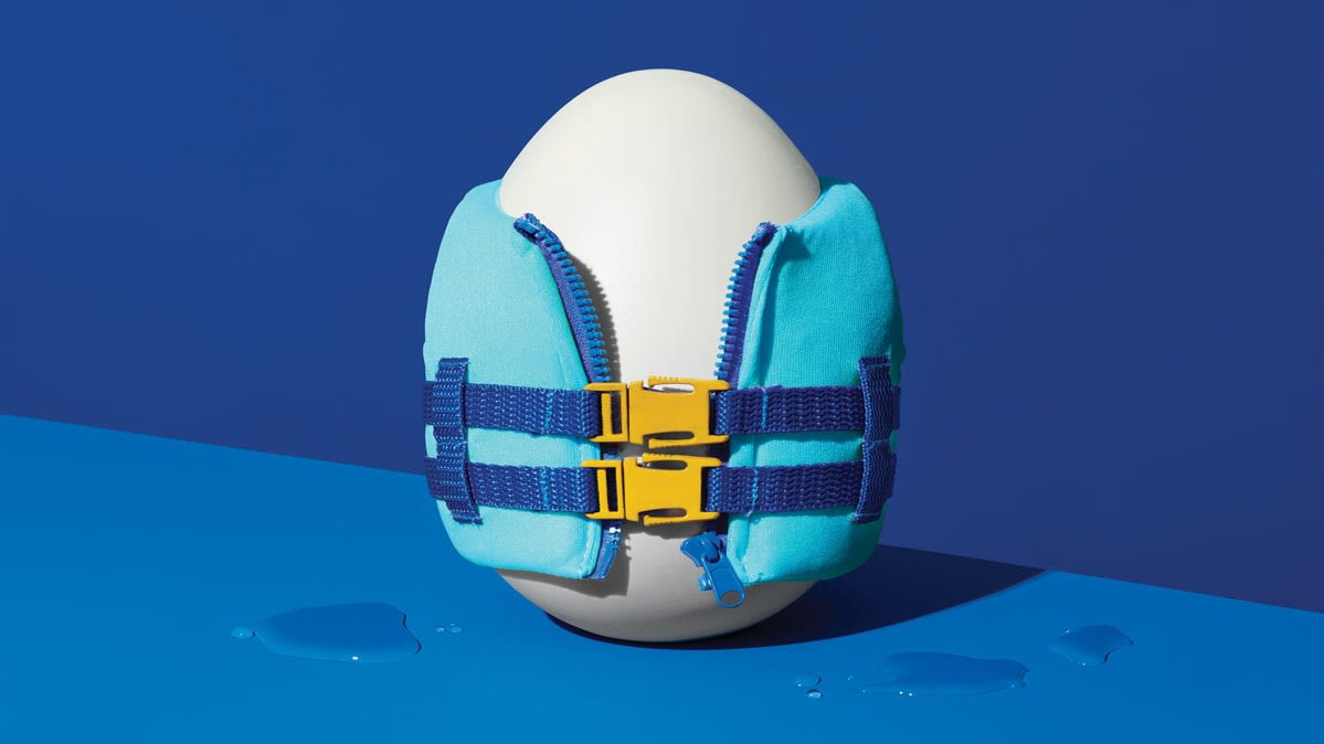 Illustration of an egg wearing a life jacket, symbolizing saving a retirement nest egg