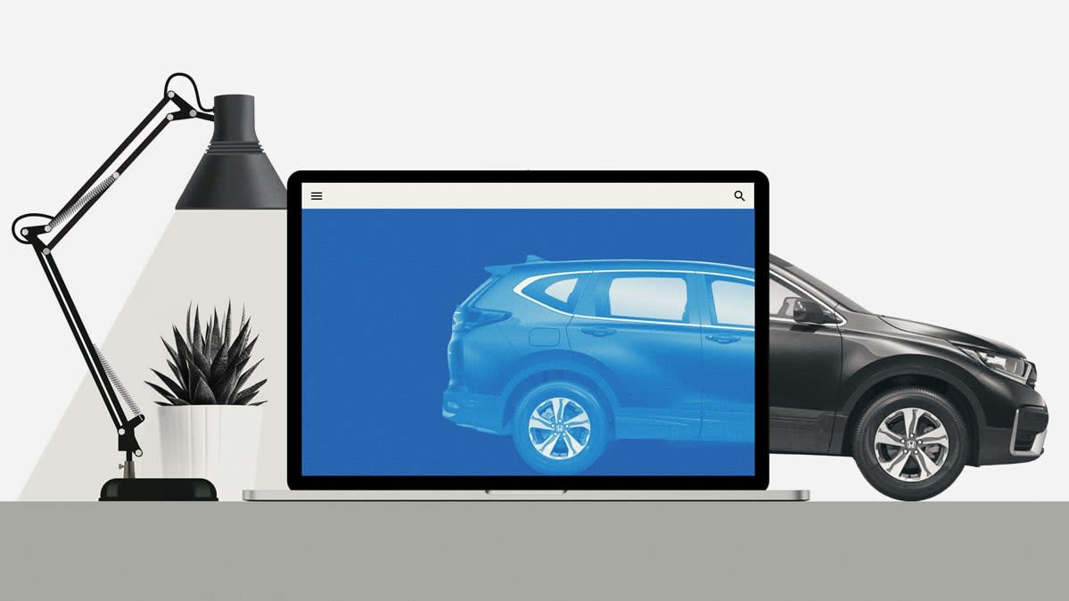 A photo illustration of a car on a computer monitor becoming the actual car