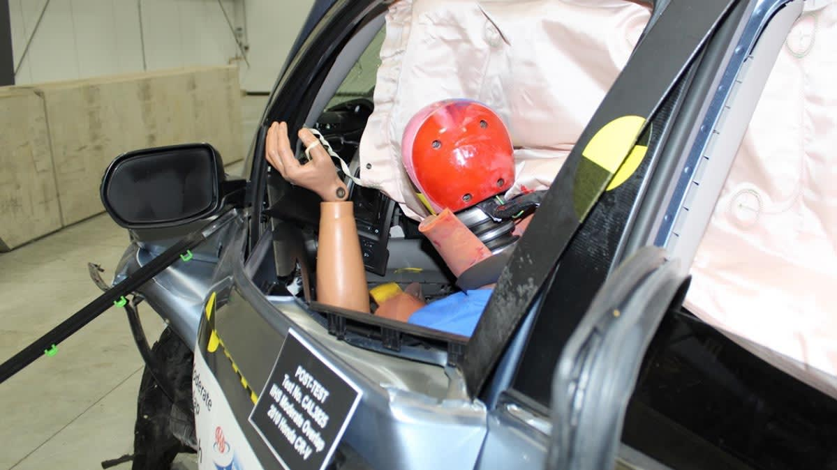 A car after an crash test, with a crash test dummy in the front seat