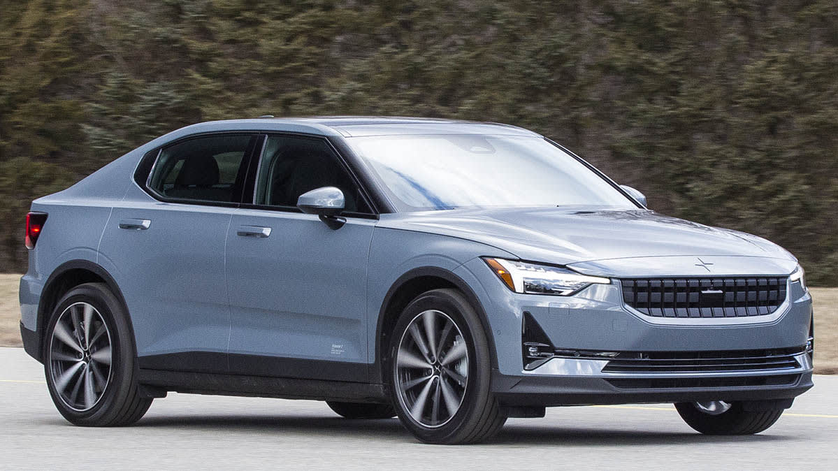 A light-blue 2021 Polestar 2 EV driving