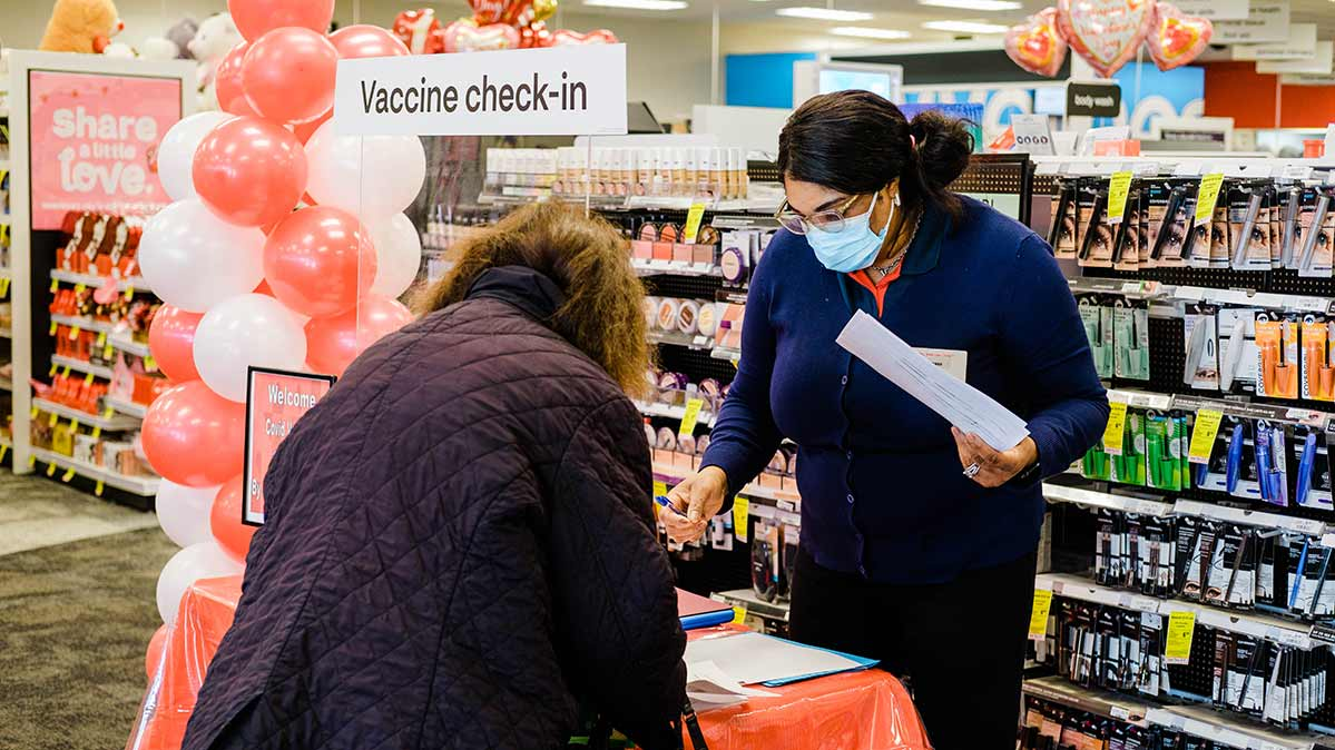 A consumer at a CVS Pharmacy in Eastchester, New York, signing in for a COVID-19 vaccination